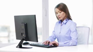 business, office, school and education concept - busy businesswoman with computer in office