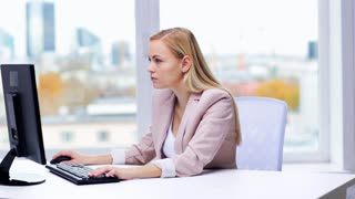 business, people, stress, problem and technology concept - young businesswoman with computer typing at office