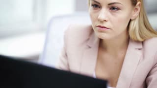 business, people, stress, problem and technology concept - young businesswoman with computer working at office