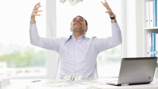 business, people, success and fortune concept - happy businessman throwing up dollar money and sitting at table in office