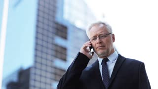 business, technology, communication and people concept - angry senior businessman calling on smartphone and shouting in city