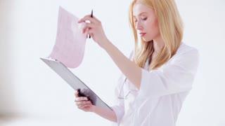 closeup of female doctor making a prescription