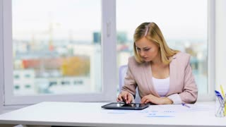 education, business and technology concept - businesswoman with tablet pc computer and papers in office