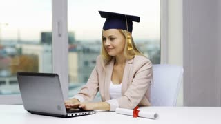 education, graduation, people, high school and technology concept - student girl or woman in bachelor cap with laptop and diploma