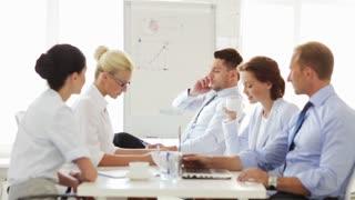 group of business people having a coffee break during meeting