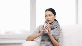 healthcare and medicine concept - ill woman with flu at home