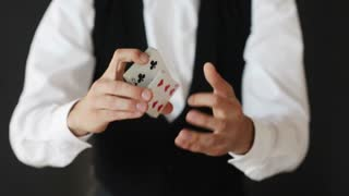 magic card tricks, gambling, casino, poker concept - man showing trick with playing cards
