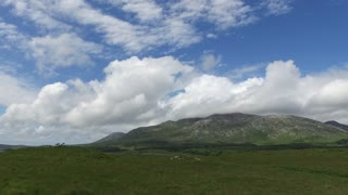 nature and landscape concept - hills or mountains and plains of connemara in ireland