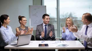 office and teamwork concept - group of business people applauding on meeting