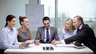 office and teamwork concept - group of business people having a meeting