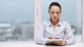 office, business, technology and internet concept - serious businesswoman with tablet pc
