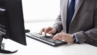 people, business, technology and office work concept - close up of businessman hands typing on computer keyboard