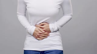 people, healthcare and problem concept - woman suffering from stomach ache