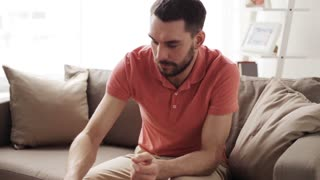 people, healthcare, dentistry and problem concept - unhappy man suffering toothache at home
