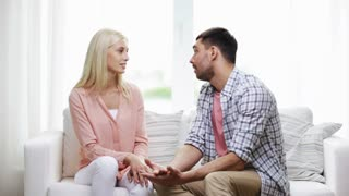 people, relationship difficulties, conflict and family concept - unhappy couple having argument at home