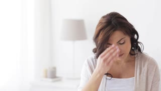 pregnancy, health, people and expectation concept - pregnant woman in bed suffering from headache at home