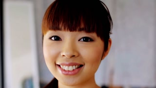 race, ethnicity, people, emotion and facial expression concept - face of happy smiling asian young woman