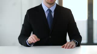 business, augmented reality and future technology concept - businessman working with something imaginary