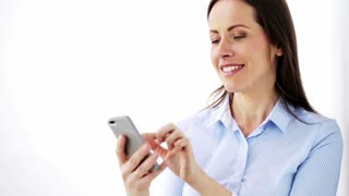 business, corporate, technology and people concept - happy smiling businesswoman with smartphone at office