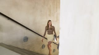 business, people and corporate concept - businesswoman and businessman with folders walking upstairs and talking