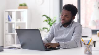 business, people, deadline and technology concept - stressed african american businessman with laptop working computer at office