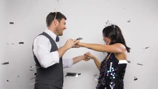 celebration, people and holidays concept - happy couple dancing at christmas or new year party