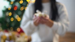 holidays, presents, new year and celebration concept - woman holding christmas gift box