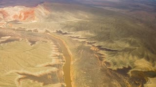landscape and nature concept - aerial view of grand canyon and colorado river from helicopter