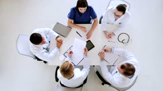 medicine, healthcare and people concept - group of doctors on conference making high five gesture at hospital