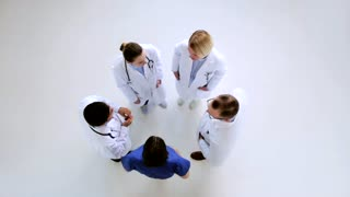 medicine, healthcare and people concept - group of doctors talking at hospital