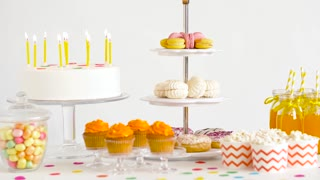 party and festive concept - birthday cake, drinks and food on table