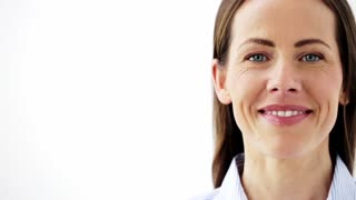 people, emotion and facial expression concept - face of happy smiling middle aged woman