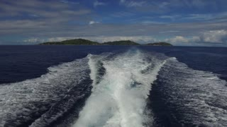 travel, seascape and nature concept - sea or indian ocean and leaving boat trace on water