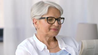 vision, age and people concept - portrait of happy senior woman in glasses