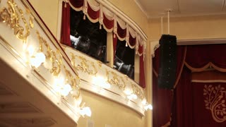 A balcony with lighting equipment in the theatre