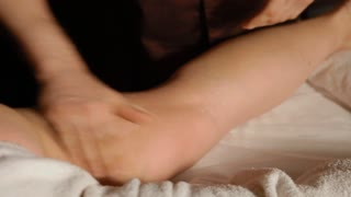 A fat woman is having an intensive massage. The aim is to lose weight. An anti-cellulite effect. Hands are quickly massaging the woman's leg