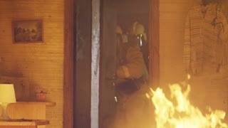 A firefighter in a burning building