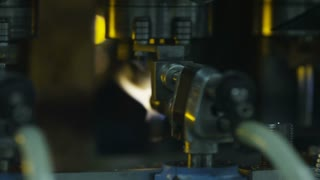 A flamethrower at the glass-blowing plant
