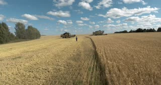 A harvesting machine on a large field