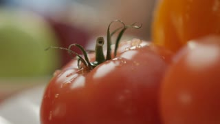 A tomato on the plate