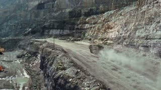 Aerial. A big truck is transporting ground in a quarry