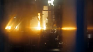 An automated furnace that heats and blows plastic bottles from preforms