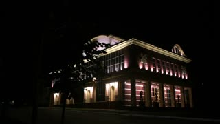 An exterior of a theater at night