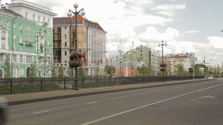 Big russian city in summer. Transport is moving on the roadway
