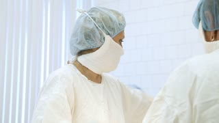 doctors perform surgery in  operating room