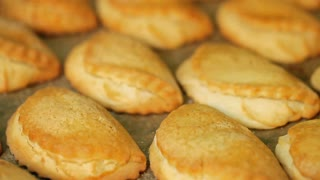 Fragrant yellow pies are just from the oven