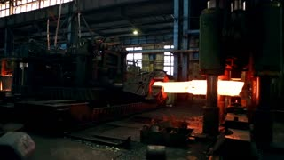 Pressing metal at the steel mill