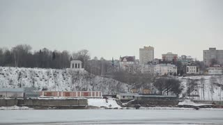 Russia, Kirov. A typical city in Russia near the river. There are old and new buildings, a church on the shore