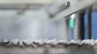 Sorting of glass products at the glass-blowing plant