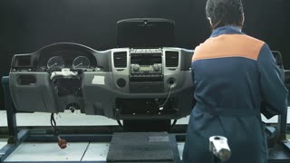 The assembling of a car dashboard by a specialist